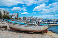 Old boats south of italy little in the harbor mola di bari Stock Photo