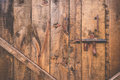 Old bolt open over wood door Royalty Free Stock Photo