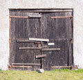 Old bolted wooden gate Royalty Free Stock Photo