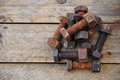 Old bolts or dirty bolts on wooden background, Machine equipment in industry work Royalty Free Stock Photo
