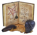 Old book with black skull and feather isolated Stock Photography