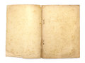 Old book with blank yellow stained pages Royalty Free Stock Photo