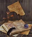 Old book crystal ball black quill Stock Photography