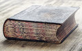 Old book historical on wooden table Royalty Free Stock Photos