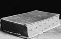 Old book rests on a wooden box Royalty Free Stock Photography