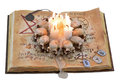 Old book with scary candles and runes isolated Stock Photo