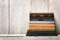 Old book shelf blank spines empty binding stack on wood texture background knowledge concept Royalty Free Stock Photos