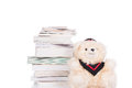 Old book and teddy bear wearing gown Royalty Free Stock Photo
