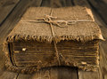 Old book wrapped in canvas Royalty Free Stock Images