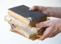 Old books held by man a holds several damaged Stock Photography