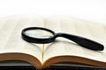 Old books with magnifying glass.