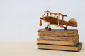 old books next to plane toy on wooden table Royalty Free Stock Photo