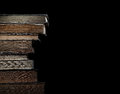 Old Books In Pile On A Black B...
