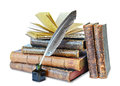 Old books pile of the and a quill in the inkwell on a white background Royalty Free Stock Photo