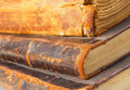 Old books stacked close up detail horizontal composition Stock Image