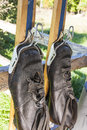 Old boots in ski clamps black leather ancient Royalty Free Stock Photos