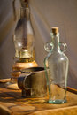 Old Bottle, Lantern, and Drinking Cup Stock Photos