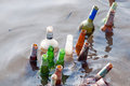 Old bottles float in the river Royalty Free Stock Images