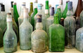 Old bottles on a shelf Royalty Free Stock Photo
