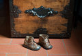 Old boy shoes and steamer Royalty Free Stock Photo
