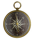 Old brass antique compass with dark face isolated Royalty Free Stock Photo