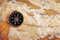 Old brass compass on a Treasure map Royalty Free Stock Photography