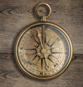 Old brass compass on wood table