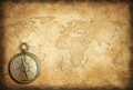 Old brass or golden compass with world map background Royalty Free Stock Photo
