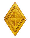 Old brass rhombus Royalty Free Stock Photo