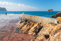 Old breakwater pier in petrovac montenegro town adriatic sea Royalty Free Stock Images