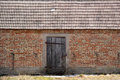 Old brick barn with wooden doors Royalty Free Stock Photo