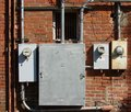 Old brick building and electrical meters Royalty Free Stock Photo