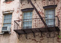Old brick building with fire escapes in front, Manhattan, New Yo Royalty Free Stock Photo