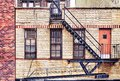 Old brick building with fire escapes, New York City. Royalty Free Stock Photo
