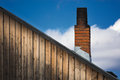 The old brick chimney on the roof Royalty Free Stock Photo