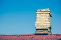 Old brick chimney on the roof for the smoke Royalty Free Stock Photo