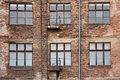 Old brick facade wall with windows Royalty Free Stock Image