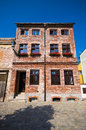 Old brick made tenement house style Stock Photography