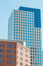 Old brick and modern blue glass building an with a high rise in background in denver colorado Royalty Free Stock Image
