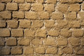 Old brick ochre painted wall. Background texture Royalty Free Stock Photo