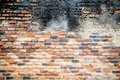 Old brick wall in a background image   with vignetted  grunge ba Royalty Free Stock Photo
