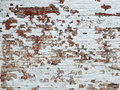 Old brick wall background with white paint Royalty Free Stock Photo