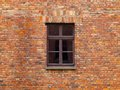 Old brick wall with brown window Royalty Free Stock Photo