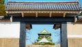 Old brick wall and ceramic roof  from osaka castle with blue sky Royalty Free Stock Photo