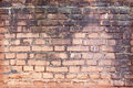 Old brick wall cracked concrete vintage background Stock Photo