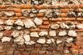 Old brick wall with crumbling bricks Royalty Free Stock Photo