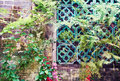 Old brick wall with flower flowers Royalty Free Stock Photo