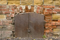 Old brick wall metal door with the lock Royalty Free Stock Photography