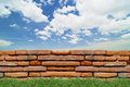 Old brick wall under the blue sky Royalty Free Stock Photo