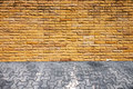 Old brick wall and walkway Royalty Free Stock Photography